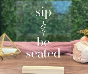 sip and be seated table sign ee